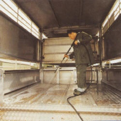 Disinfecting a pig transporter
